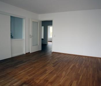 Wohnung_im_Mehrfamilienhaus_NEUBAU_Stadtmitte_Wiesbaden_Immoro_Immobilienmakler-Wiesbaden_2015_Wohnzimmer